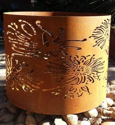 Large Round Fire Pit in Firewheel Pattern by Ironbark Metal Design