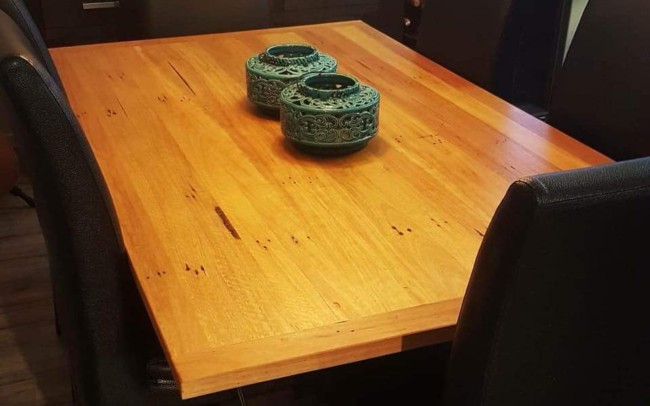 Hardwood Table Top with Angled Steel Legs by Ironbark Metal Design