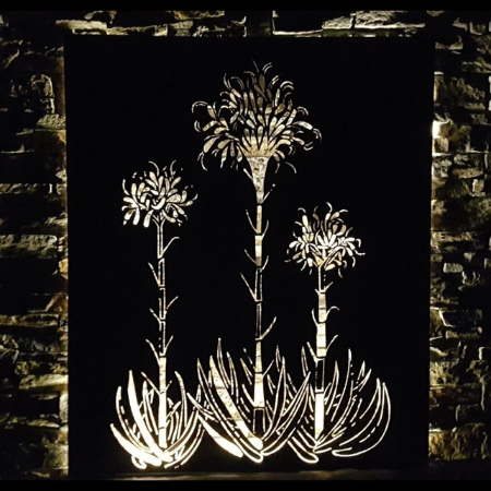 Gymea Lilies Wall Art in Rusted Steel with Lighting at Night