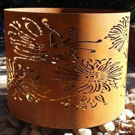 Large Round Fire Pit with Firewheel Pattern in Steel